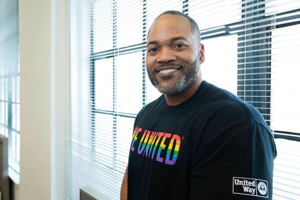 Black man wearing a Live United T-shirt